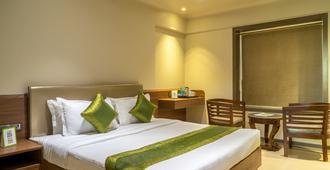 橄榄之家翠波酒店 - 孟买 - 睡房