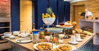 Nh波哥大帕维永罗伊尔酒店 - 波哥大 - 餐馆