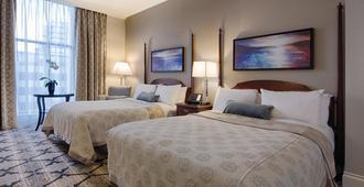 白玉兰及温泉酒店 - 维多利亚 - 睡房