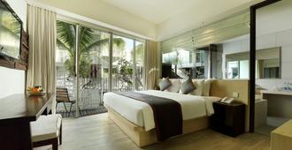 勒吉安阿卡马尼酒店 - 库塔 - 睡房