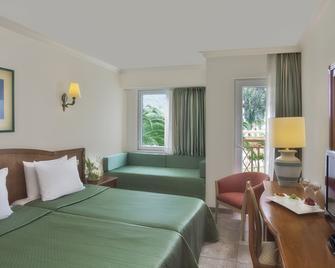 阿卡克拉罗斯酒店 - Kiris - 睡房