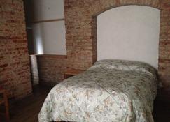 布格姆比利亚斯酒店 - 巴耶-德布拉沃 - 睡房