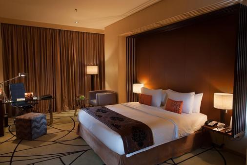 棉兰瑞士-贝尔酒店 - 棉兰 - 睡房
