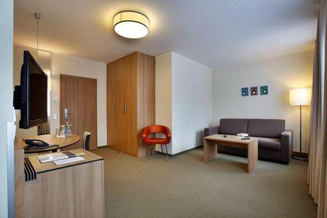 艾姆吉克奥布斯马特城市伙伴酒店 - 纽伦堡 - 客厅