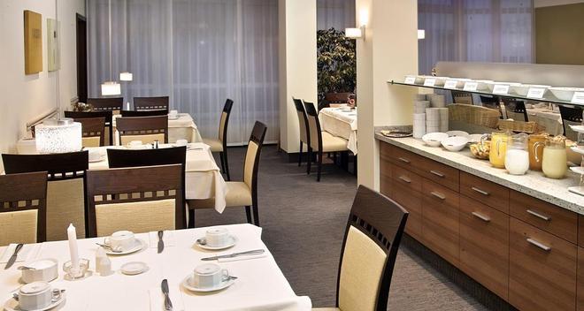 艾姆吉克奥布斯马特城市伙伴酒店 - 纽伦堡 - 餐馆