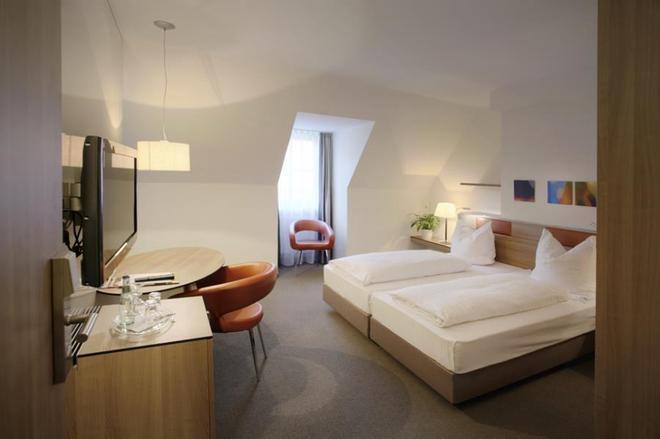艾姆吉克奥布斯马特城市伙伴酒店 - 纽伦堡 - 睡房