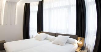 圣地亚哥力士酒店 - 圣地亚哥-德孔波斯特拉 - 睡房