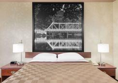 莫米速8酒店 - 莫米 - 睡房