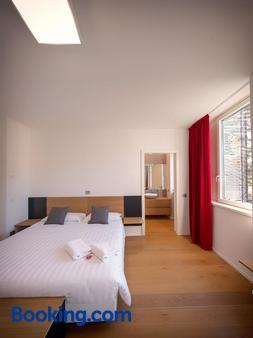 拉维豪华旅馆 - 特伦托 - 睡房