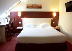 凯里亚德酒店-博讷市 - 博恩 - 睡房