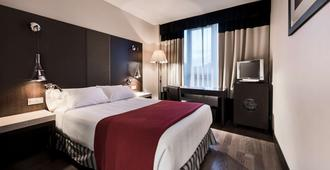 瓦拉多利巴拉格nh酒店 - 巴利亚多利德 - 睡房