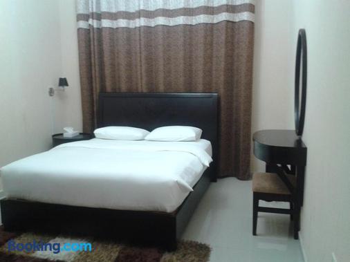 阿尔斯姆公寓酒店 - 阿吉曼 - 睡房