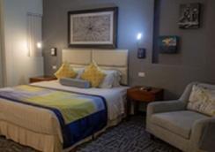 塞班世纪酒店 - 加拉班 - 睡房