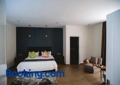 白色精品酒店和公寓 - 西哈努克市 - 睡房