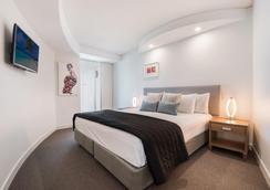 西罗科曼特拉酒店 - 穆卢拉巴 - 睡房