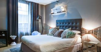 巴黎多韦涅旅游酒店 - 巴黎 - 睡房