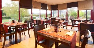 基里亚德德维勒圣阿尔努特酒店 - 多维尔 - 餐馆