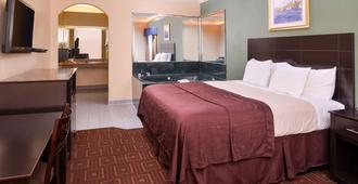 贝敦美洲最佳价值酒店 - 贝敦 - 睡房