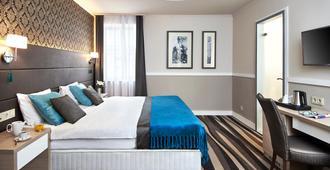 贝斯里卡中心酒店 - 布达佩斯 - 睡房