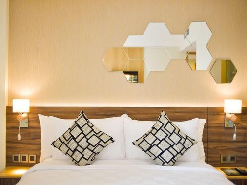 金色郁金香基本丹格朗酒店 - 当格浪 - 睡房