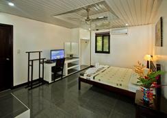 壁虎之家紫藤花园旅馆 - 普林塞萨港 (公主港) - 睡房