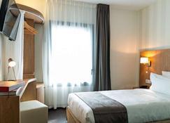 乐榭莱昂酒店 - 图卢兹 - 睡房