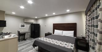 经济套房酒店 - 巴吞鲁日 - 睡房
