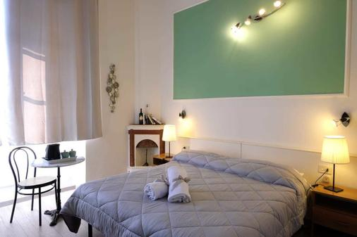 雷隆狄尼住宅酒店 - 佛罗伦萨 - 睡房