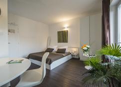格比萨酒店 - 勒皮 - 睡房