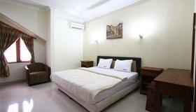 旁多克槟榔 2 号瑞德多兹酒店 - 雅加达 - 睡房