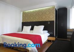 金狮酒店 - 布卡拉曼加 - 睡房