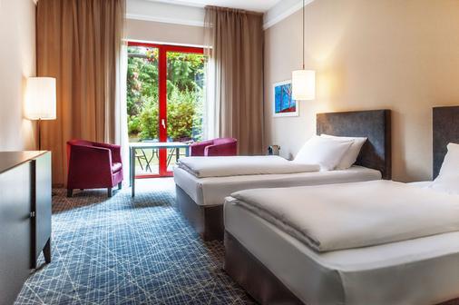 布拉格nh精选酒店 - 布拉格 - 睡房