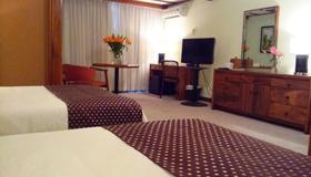 图尔农别墅酒店 - 圣荷西 - 睡房