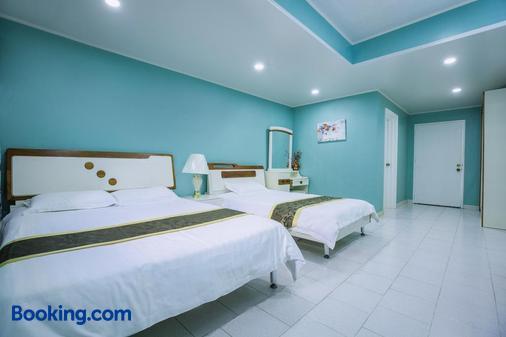 塞班岛海滩花园酒店公寓 - 加拉班 - 睡房