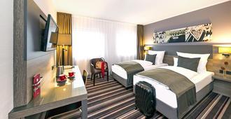 纽伦堡莱昂纳多酒店 - 纽伦堡 - 睡房