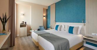 法罗酒店及海滩俱乐部 - 法鲁 - 睡房