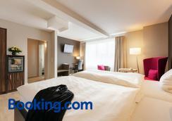 希曼高级酒店 - 莱比锡 - 睡房