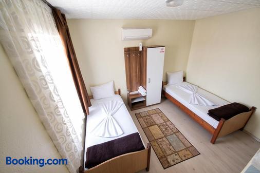 黄玫瑰旅馆 - 恰纳卡莱 - 睡房