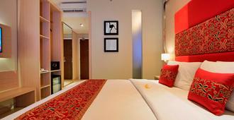 库塔奥纳酒店 - 库塔 - 睡房