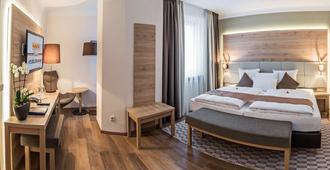 三头狮酒店 - 慕尼黑 - 睡房