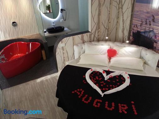 普里玛维拉环保酒店 - 加尔达湖滨 - 睡房
