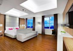 巴东奥罗菲芙酒店 - 巴东 - 睡房