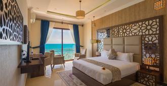 金色郁金香桑给巴尔度假酒店 - 桑给巴尔 - 睡房