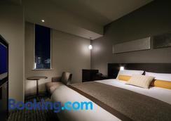 仙台华盛顿酒店 - 仙台 - 睡房