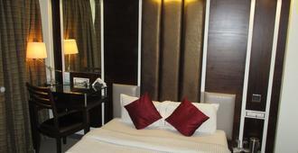 萨普纳海洋酒店 - 孟买 - 睡房