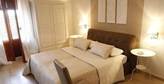 席莫尼塔客房酒店 - 诺托 - 睡房
