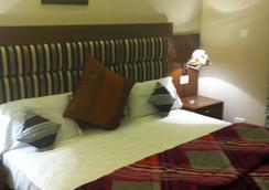 机场地铁大厦酒店 - 新德里 - 睡房