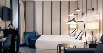 美居加迪纳斯德艾碧亚酒店 - 毕尔巴鄂 - 睡房