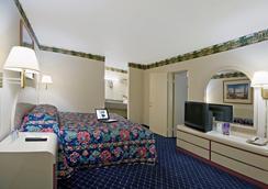 道尔顿美洲最佳价值套房酒店 - 多尔顿 - 睡房