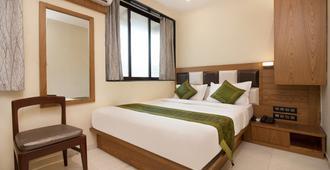 特雷布旅行公园住宅酒店 - 孟买 - 睡房